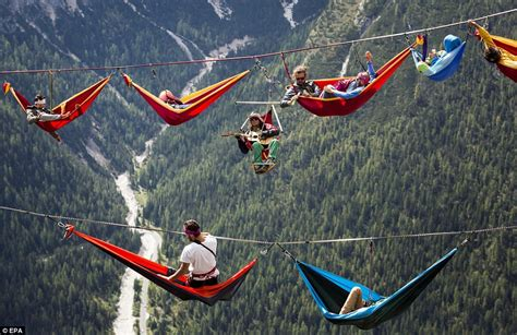 Thrillseekers pictured sleeping thousands of feet above